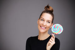 Happy woman with lollipop Royalty Free Stock Photography