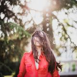 Happy woman with long beautiful hair laughing. Wearing red shirt Royalty Free Stock Photo