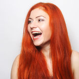 happy woman with long flowing red hair Stock Image