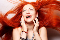 happy woman with long flowing red hair Royalty Free Stock Images