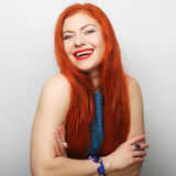 happy woman with long flowing red hair Royalty Free Stock Photo