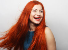 Happy woman with long flowing red hair Stock Photography