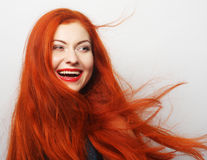 Happy woman with long flowing red hair Royalty Free Stock Image