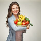 Happy woman with long hair and big toothy smile holding straw ba. Sket with healthy food fruits and vegetables Stock Photo