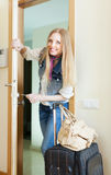 Happy  woman  loocking door and leaving her home Stock Photos