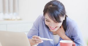 Happy woman look pregnancy test royalty free stock photo