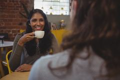 Free Happy Woman Looking At Friend While Having Coffee Stock Image - 99479941