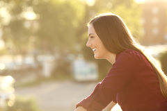 Happy woman looking away in a balcony Stock Photos