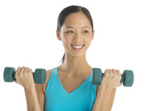 Happy Woman Looking Away While Lifting Dumbbells Royalty Free Stock Photo