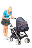 Happy woman looking in a baby stroller Stock Photography