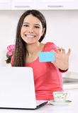 Happy woman looking backward with laptop Stock Photography