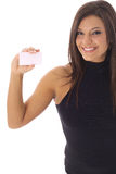 Happy woman looking at a business card vertical Royalty Free Stock Images