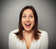 Happy woman looking at camera Stock Images
