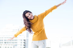 Happy woman looking camera with arms raised on Royalty Free Stock Photos