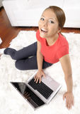 Happy woman looking at camera with laptop Royalty Free Stock Photos