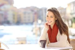 Happy woman looking at camera in a coffee shop of a port royalty free stock photo
