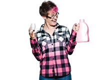 Happy woman looking at detergent bottle with dyed shirt Stock Photography