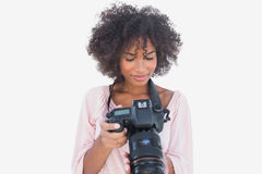 Happy woman looking at digital camera Stock Photo
