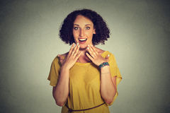 Happy woman looking excited, surprised in full disbelief, hands on chest, it's me? Royalty Free Stock Photos