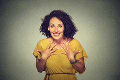 Happy woman looking excited, surprised in full disbelief, hands on chest, it's me? Stock Image