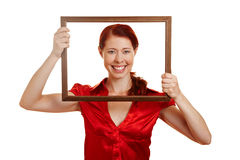 Happy woman looking through frame Stock Photos
