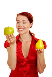 Happy woman looking at fruits Stock Photos