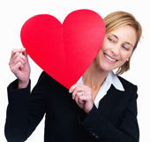 Happy woman looking at the heart in hand Stock Photo