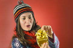 Happy Woman Looking at her Gift Royalty Free Stock Photography