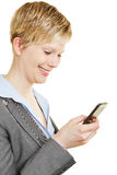 Happy woman looking at her smartphone Royalty Free Stock Images