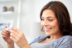 Happy woman looking at home pregnancy test Royalty Free Stock Images