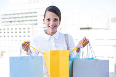 Happy woman looking inside shopping bags Stock Photo
