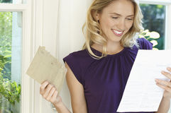 Happy Woman Looking At Letter Stock Images