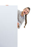 Happy woman looking out from blank billboard Stock Photography