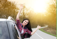 Happy woman looking out of the car Stock Photography