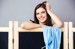 Happy woman looking out from the locker room Royalty Free Stock Photos