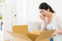 Happy woman looking at personal parcel box Stock Photography