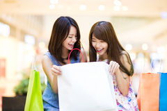 Happy woman looking at shopping bag at   mall Royalty Free Stock Photos