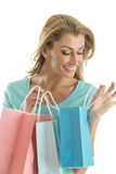 Happy Woman Looking Into Shopping Bag Stock Photography