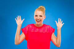 Happy woman looking surprised with hands up. Stock Photo
