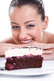 Happy woman looking in tasty cakes Stock Photos