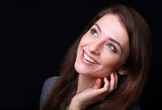 Happy woman looking up on black. Happy beautiful woman looking up on black background Royalty Free Stock Photos