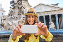 Happy woman looking up from taking photos at Pantheon Stock Photography