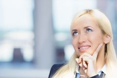 Happy woman looking upwards daydreaming Stock Images