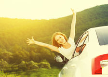 Happy woman looks out the car window on nature Royalty Free Stock Photography