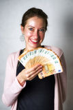 Happy woman with a lot of money Stock Photo