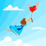 Happy woman in love flying on heart balloon in the sky around clouds. Beautiful girl in love. Happy woman in love flying on heart balloon in the sky around Royalty Free Stock Photo