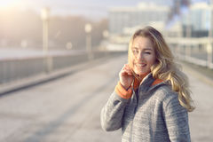 Happy woman with a lovely smile on a winter street Stock Photo
