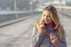 Happy woman with a lovely smile on a winter street Stock Image