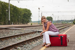 Happy woman with luggage Royalty Free Stock Photos