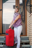 Happy woman with luggage Royalty Free Stock Photography